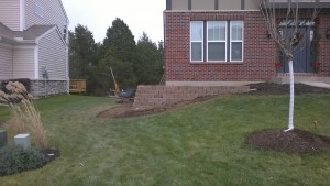 Project Complete: Wall, Landscaping Creates Instant Curb Appeal